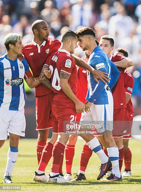 Vitolo of Sevilla FC clashes with Carl Medjani of Deportivo Leganes as Ruben Perez of Deportivo Leganes is injured during their La Liga match between...
