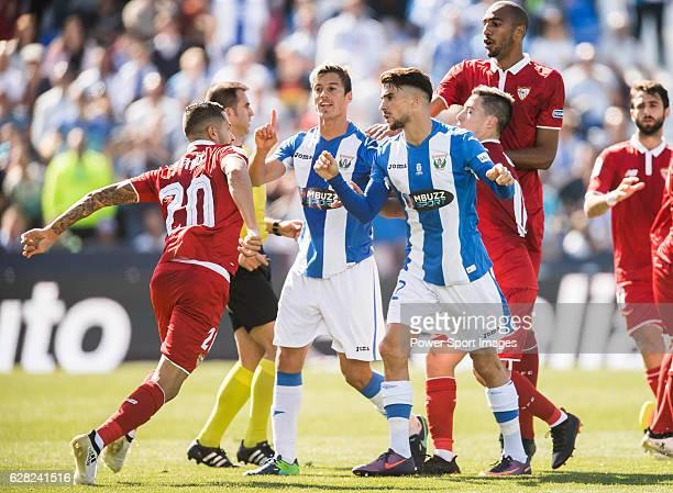 Vitolo of Sevilla FC clashes with Martin Mantovani and Carl Medjani of Deportivo Leganes as Ruben Perez of Deportivo Leganes is injured during their...