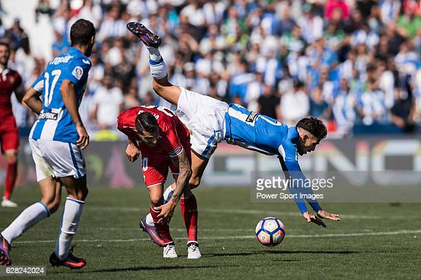 Vitolo of Sevilla FC competes for the ball with Carl Medjani of Deportivo Leganes during their La Liga match between Deportivo Leganes and Sevilla FC...