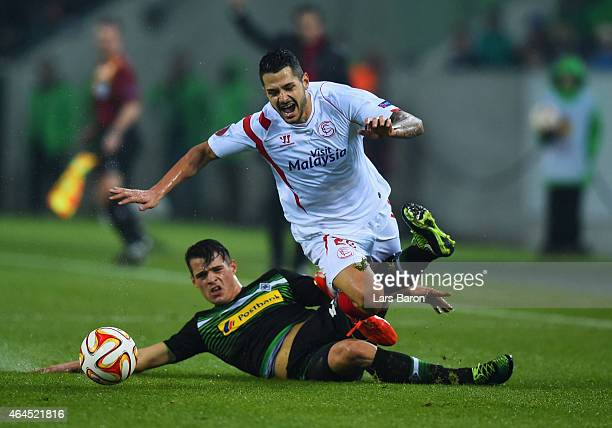 Vitolo of Sevilla is tackled by Granit Xhaka of Borussia Moenchengladbach during the UEFA Europa League Round of 32 second leg match between Borussia...