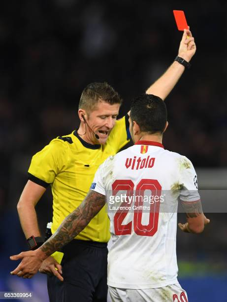 Vitolo of Sevilla remonstrates with referee Daniele Orsato of Italy as he shows the red card to Samir Nasri of Sevilla during the UEFA Champions...