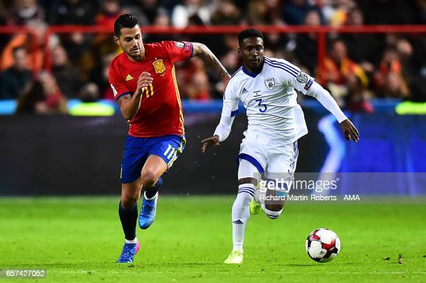 Vitolo of Spain competes with Taleb Twatha of Israel during the FIFA 2018 World Cup Qualifier between Spain and Israel at Estadio El Molinon on March...