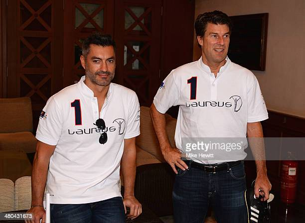 Vitor Baia and Michael Laudrup look on during the Laureus All Stars Unity Cup ahead of the 2014 Laureus World Sports Awards at Royal Selangor Club on...