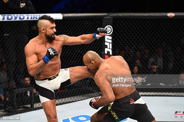 Vitor Belfort of Brazil lands a knee to the chin of Ronaldo 'Jacare' Souza of Brazil in their middleweight bout during the UFC 198 event at Arena da...