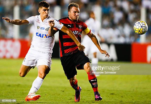 Vitor Bueno of Santos and Willian Farias of Vitoria in action during the match between Santos and Vitoria for the Brazilian Series A 2016 at Vila...
