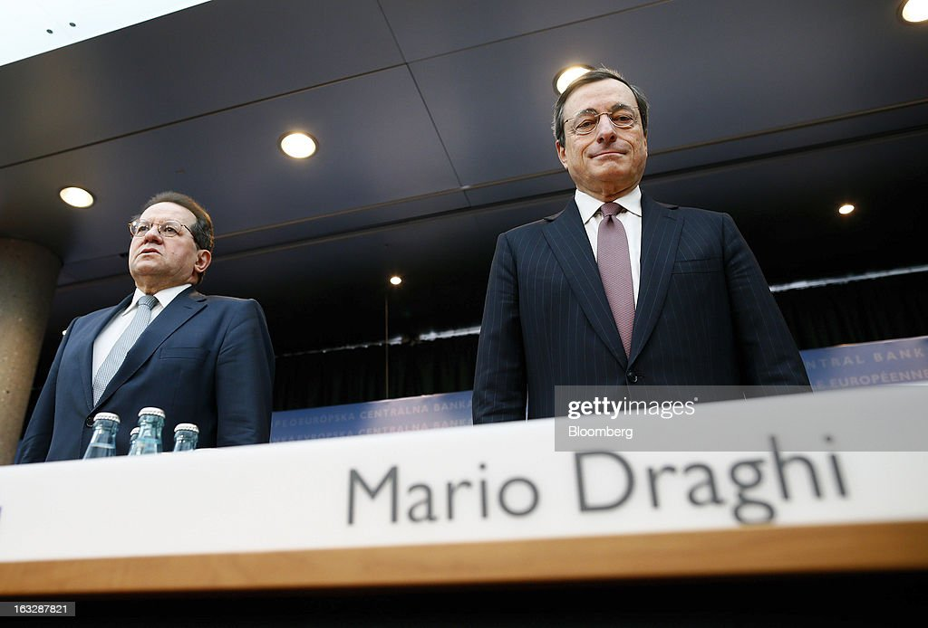 Vitor Constancio, vice president of the European Central Bank, left, and Mario Draghi, president of the European Central Bank (ECB), take their seats ahead of a news conference at the bank's headquarters in Frankfurt, Germany, on Thursday, March 7, 2013. Draghi stuck to his view that the euro-area economy will gradually recover later this year as policy makers trimmed their economic and inflation forecasts. Photographer: Ralph Orlowski/Bloomberg via Getty Images