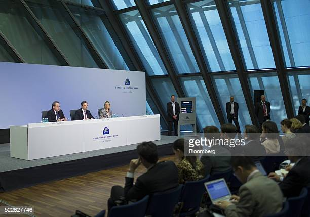 Vitor Constancio vice president of the European Central Bank left speaks as Mario Draghi president of the European Central Bank center and Christine...