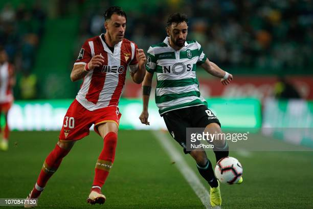 Vitor Gomes of Desportivo Aves vies for the ball with Bruno Fernandes of Sporting during Primeira Liga 2018/19 match between Sporting CP vs CD Aves...