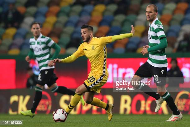 Vitor Goncalves of CD Nacional with Bas Dost of Sporting CP in action during the Liga NOS match between Sporting CP and CD Nacional at Estadio Jose...