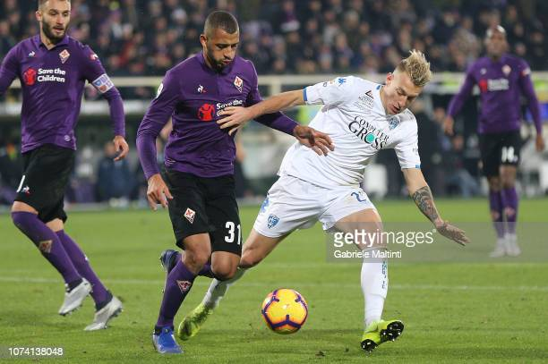 Vitor Hugo of ACF Fiorentina battles for the ball with Antonino La Gumina of Empoli FC during the Serie A match between ACF Fiorentina and Empoli at...