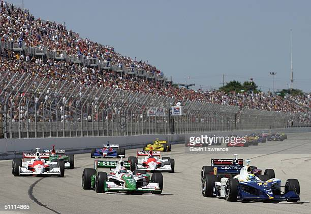 Vitor Meira driving the Rahal Letterman Racing Honda GForce leads Tony Kanaan in the Andretti Green Racing Team 7Eleven Honda Dallaraat the start of...