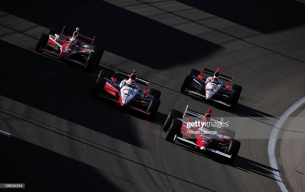 Vitor Meira of Brazil driver of the #14 A. J. Foyt Enterprises Dallara Honda leads a pack of cars during practice for the IZOD IndyCar Series World Championship on October 14, 2011 at the Las Vegas Motor Speedway in Las Vegas, Nevada.