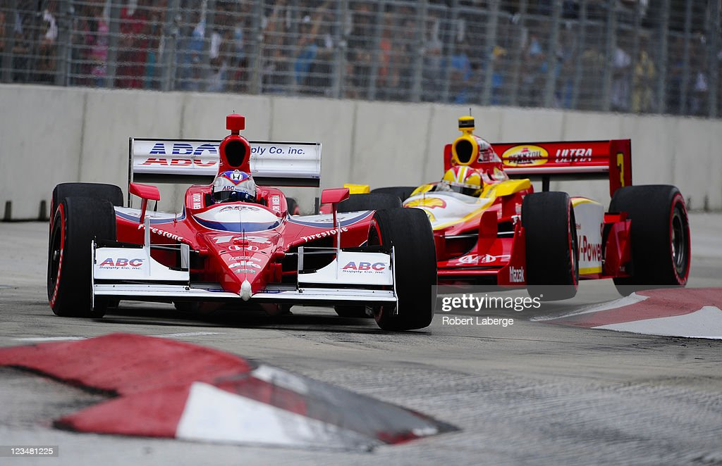 Vitor Meira of Brazil driver of the #14 A. J. Foyt Enterprises Dallara Honda leads Helio Castroneves during practice for the IZOD IndyCar Series Baltimore Grand Prix on September 3, 2011 on the streets of Baltimore, Maryland.