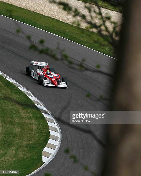Vitor Meira of Brazil driver of the AJ Foyt Enterprises Dallara Honda drives during warmups before the IndyCar Series Honda Indy Grand Prix of...