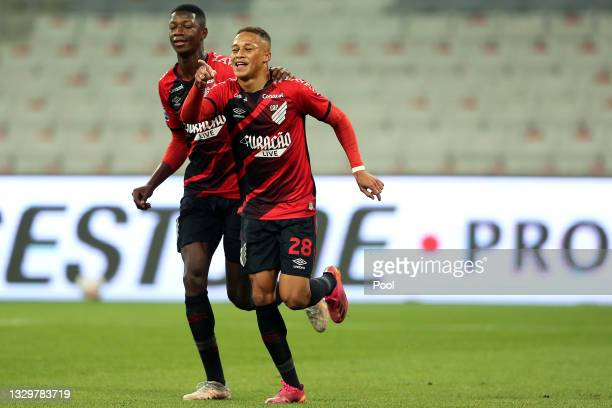 Vitor Naum of Athletico Paranaense celebrates with teammate Matheus Babi after scoring the first goal of his team during a round of sixteen second...