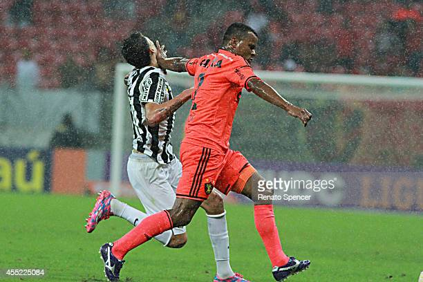 Vitor of Sport Recife battles for the ball with Thiago Ribeiro of Santos during the Brasileirao Series A 2014 match between Sport Recife and Santos...