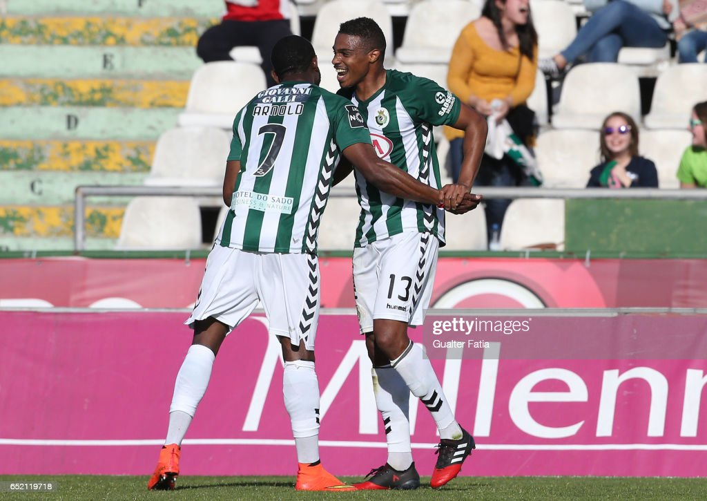 Vitoria de Setubal defender Vasco Fernandes celebrates with teammate Arnold Issoko after scoring a goal during the Primeira Liga match between Vitoria Setubal and CD Feirense at Estadio do Bonfim on March 11, 2017 in Setubal, Portugal.