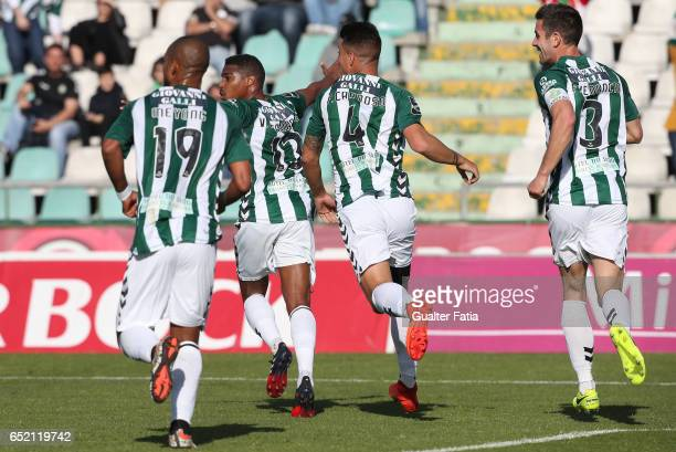 Vitoria de Setubal defender Vasco Fernandes celebrates with teammates after scoring a goal during the Primeira Liga match between Vitoria Setubal and...