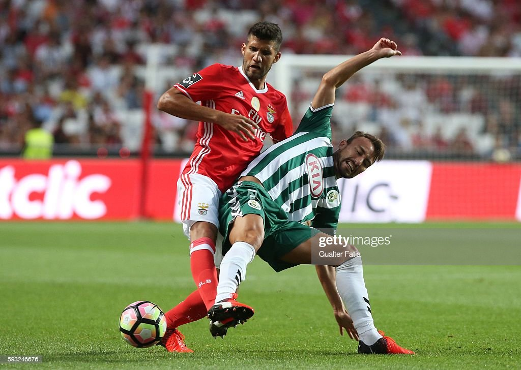 Vitoria de Setubal's forward Andre Claro tackled by SL Benfica's defender from Argentina Lisandro Lopez during the Primeira Liga match between SL Benfica and Vitoria de Setubal at Estadio da Luz on August 21, 2016 in Lisbon, Portugal.