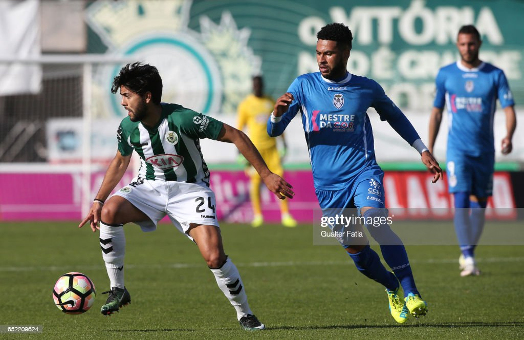 Vitoria de Setubal's forward Joao Amaral with Feirense's defender Babanco in action during the Primeira Liga match between Vitoria Setubal and CD Feirense at Estadio do Bonfim on March 11, 2017 in Setubal, Portugal.