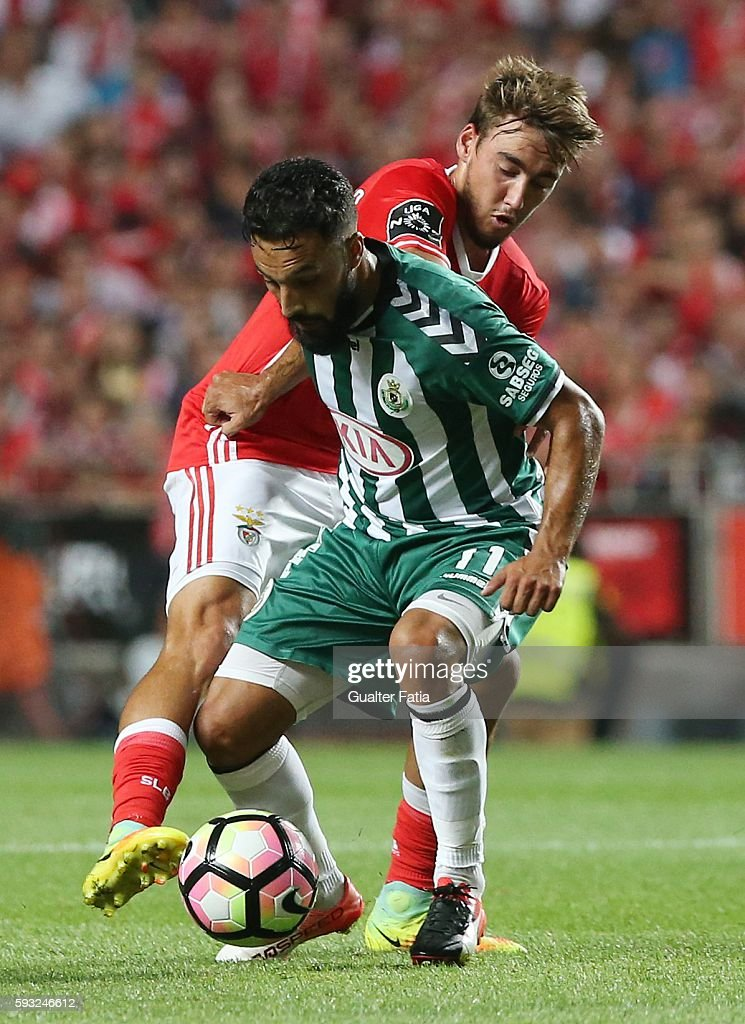 Vitoria de Setubal's forward Joao Costinha with SL Benfica's midfielder Andre Horta in action during the Primeira Liga match between SL Benfica and Vitoria de Setubal at Estadio da Luz on August 21, 2016 in Lisbon, Portugal.