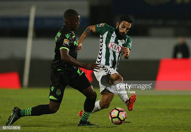 Vitoria de Setubal's forward Joao Costinha with Sporting CP's forward Joel Campbell from Costa Rica in action during Portuguese League Cup match...