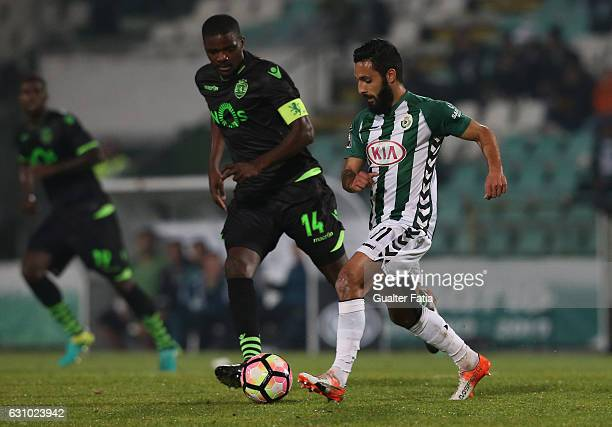 Vitoria de Setubal's forward Joao Costinha with Sporting CP's midfielder William Carvalho in action during Portuguese League Cup match between...