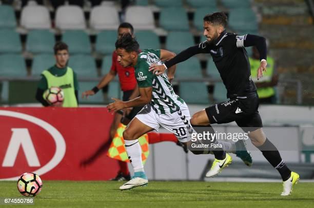 Vitoria de Setubal's midfielder Joao Carvalho with Vitoria Guimaraes' defender Josue Sa in action during the Primeira Liga match between Vitoria...