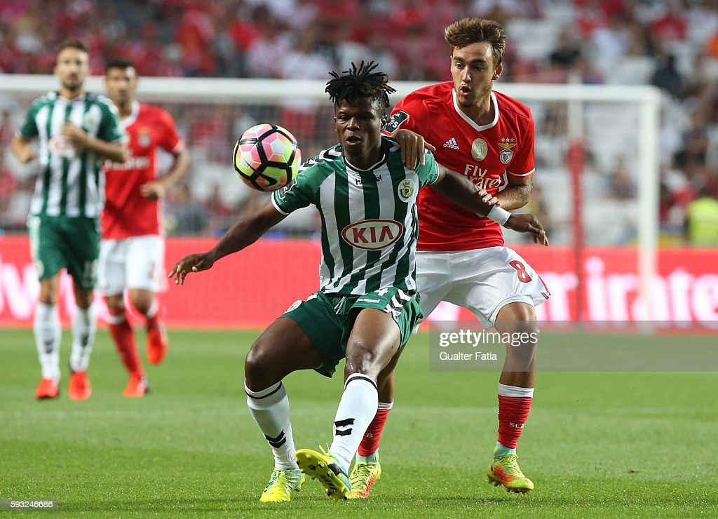 Vitoria de Setubal's midfielder Mikel Agu (L) with SL Benfica's midfielder Andre Horta (R) in action during the Primeira Liga match between SL Benfica and Vitoria de Setubal at Estadio da Luz on August 21, 2016 in Lisbon, Portugal.