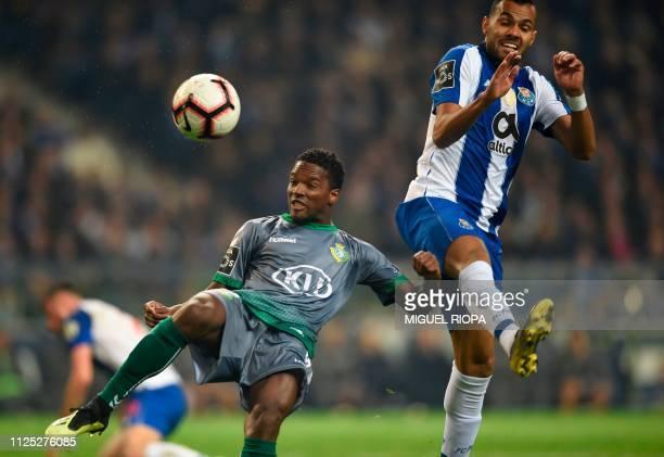 Vitoria FC's Portuguese defender Mano vies with Porto's Brazilian forward Fernando Andrade during the Portuguese League football match between Porto...