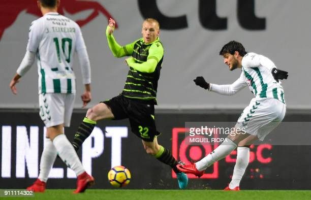 Vitoria FC's Portuguese forward Goncalo Paciencia kicks the ball next to Sporting's French defender Jeremy Mathieu and scores a goal during the...