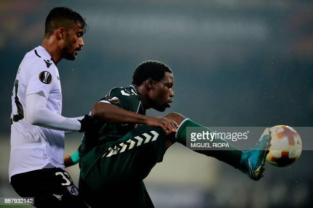Vitoria Guimaraes' Brazilian defender Jubal challenges Konyaspor's Gabonese forward Malik Evouna during the UEFA Europa League group I football match...