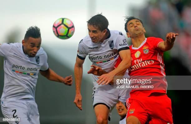 Vitoria Guimaraes' Brazilian defender Pedro Henrique and mate Brazilian midfielder Rafael Miranda vie with Benfica's Brazilian forward Jonas during...