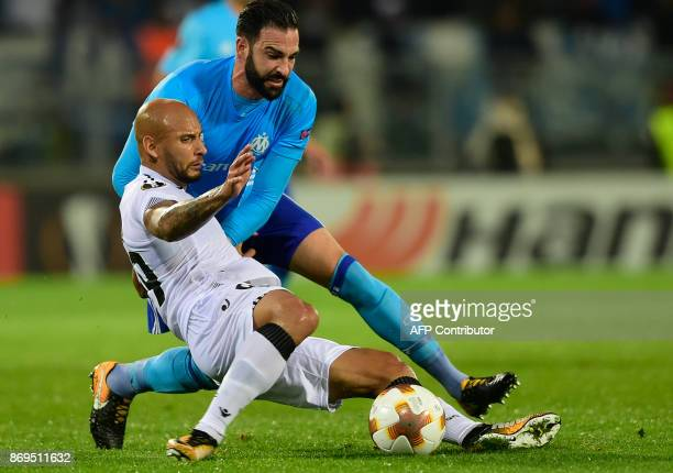 Vitoria Guimaraes' Brazilian forward Rafael Martins challenges Marseille's French defender Adil Rami during the UEFA Europa League group I football...