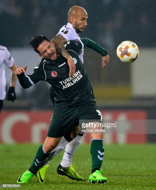 Vitoria Guimaraes' Brazilian forward Rafael Martins challenges Konyaspor's Turkish midfielder Omer Ali Sahiner during the UEFA Europa League group I...