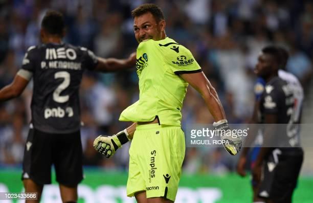 Vitoria Guimaraes' Brazilian goalkeeper Douglas bites his jersey during the Portuguese league football match between FC Porto and Vitoria Guimaraes...