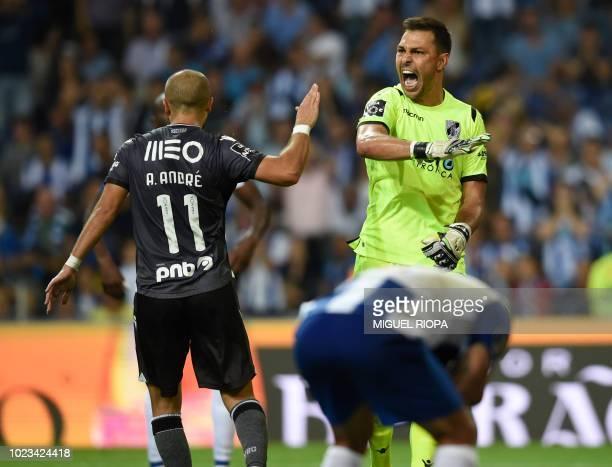 Vitoria Guimaraes' Brazilian goalkeeper Douglas gestures beside teammate Portuguese midfielder Andre Andre during the Portuguese league football...