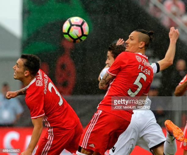 Vitoria Guimaraes' Brazilian midfielder Rafael Miranda vies with Benfica's Serbian midfielder Ljubomir Fejsa and Benfica's Spanish defender Alex...