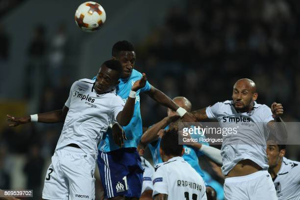 Vitoria Guimaraes defender Guislain Kona from Ivory Coast vies with Olympique Marseille forward Bouna Sarr from Guinea for the ball possession during...
