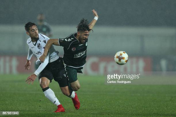 Vitoria Guimaraes defender Joao Vigario from Portugal tackles Konyaspor midfielder Vedat Bora from Turkey during the match between Vitoria Guimaraes...