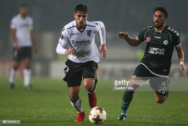 Vitoria Guimaraes defender Joao Vigario from Portugal with Konyaspor midfielder Vedat Bora from Turkey in action during the UEFA Europa League match...