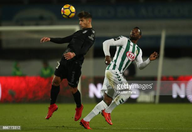 Vitoria Guimaraes defender Joao Vigario from Portugal with Vitoria Setubal forward Arnold Issoko from Congo in action during the Primeira Liga match...