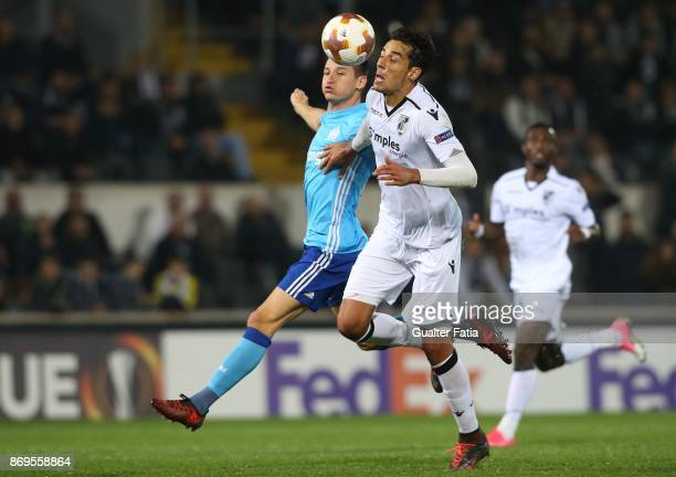 Vitoria Guimaraes defender Marcos Valente from Portugal with Olympique Marseille forward Florian Thauvin from France in action during the UEFA Europa...