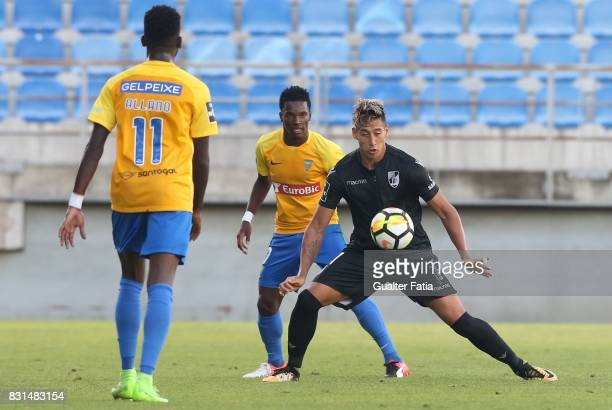 Vitoria Guimaraes forward David Teixeira from Argentina with GD Estoril Praia defender Mano from Portugal in action during the Primeira Liga match...
