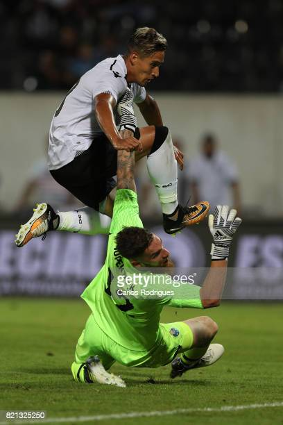 Vitoria Guimaraes forward David Texeira from Uruguay tries to pass trouth FC Porto goalkeeper Jose Sa from Portugal during the match between Vitoria...