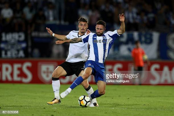 Vitoria Guimaraes forward Fabio Sturgeon from Portugal vies with FC Porto defender Miguel Layun from Mexico during the match between Vitoria...