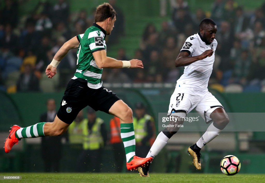 Vitoria GuimaraesÕ forward Moussa Marega with Sporting CPÕs defender Sebastian Coates from Uruguay in action during the Primeira Liga match between Sporting CP and Vitoria Guimaraes at Estadio Jose Alvalade on March 5, 2017 in Lisbon, Portugal.