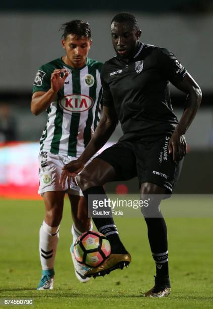 Vitoria Guimaraes' forward Moussa Marega with Vitoria de Setubal's midfielder Joao Carvalho in action during the Primeira Liga match between Vitoria...