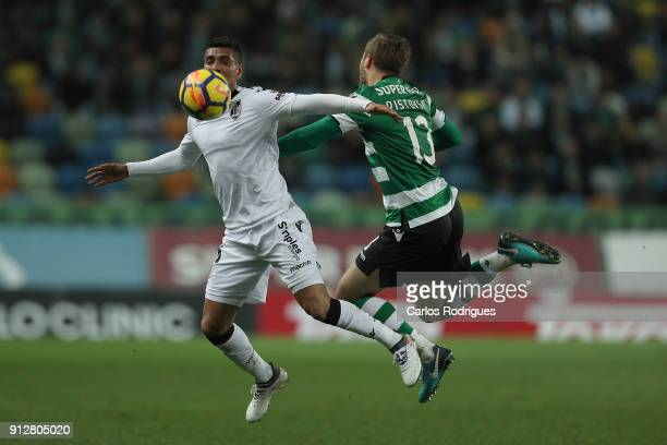 Vitoria Guimaraes forward Paolo Hurtado from Peru vies with Sporting CP defender Stefan Ristovki from Macedonia for the ball possession during the...