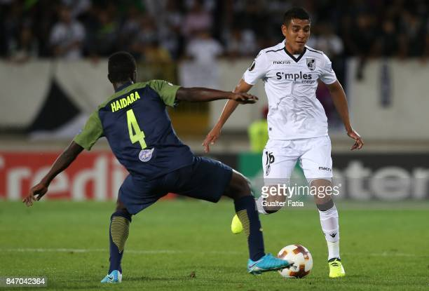 Vitoria Guimaraes forward Paolo Hurtado from Peru with RB Salzburg midfielder Mohamed Haidara from Mali in action during the UEFA Europa League match...